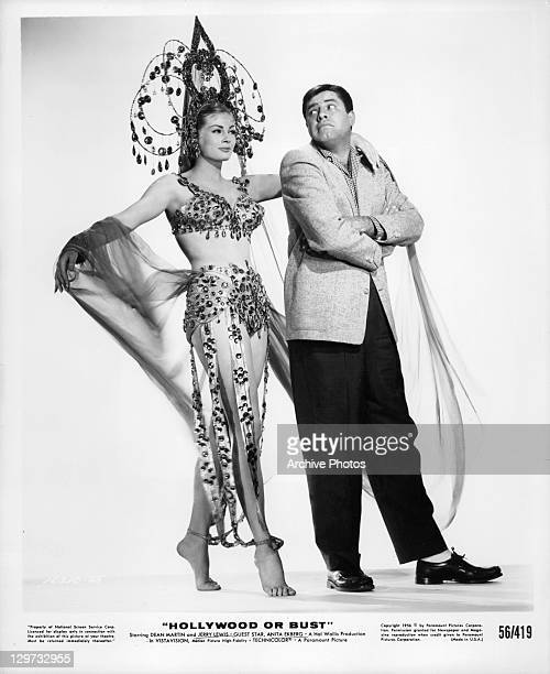 Anita Ekberg has her arm around Jerry Lewis in a scene from the film 'Hollywood Or Bust' 1956