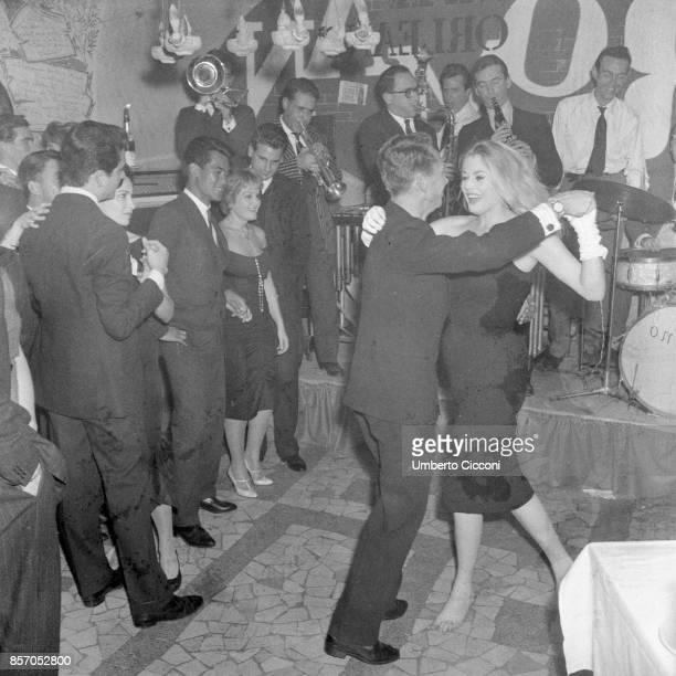 Anita Ekberg in a dance at the 'Rugantino' restaurant in Trastevere November 10 1958