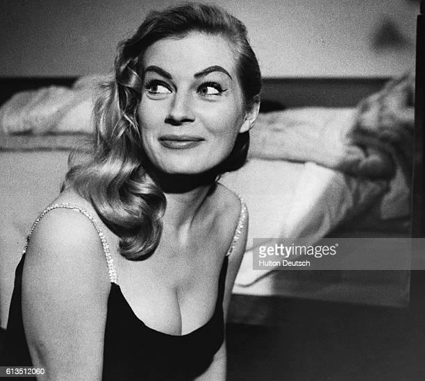 Anita Ekberg, Swedish film actress, in a room at the Savoy Hotel, 1955.