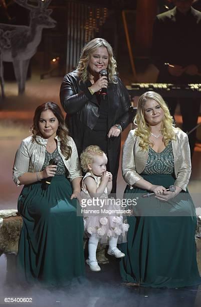Anita Hegerland and her children Greta and Kaja granddaughter Emmeline during the tv show 'Heiligabend mit Carmen Nebel' on November 23 2016 in...
