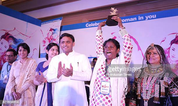 Anita Katiyar from Lakhimpur Kheri being excited as she win HT Woman award 2016 Chief minister of Uttar Pradesh Akhilesh Yadav his wife and MP from...