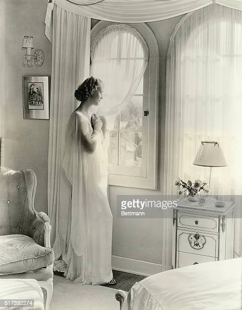 Anita Louise young Warner Bros star who enacts the tole of Titania in the film version of A Midsummer Night's Dream is photographed in the bedroom of...