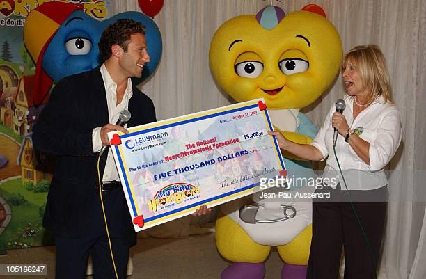 Anita Mann presenting a $ 5000 check to Mark Feuerstein to benefit The National Neurofibromatosis Foundation