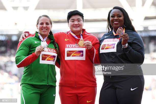 Anita Marton of Hungary, silver, Lijiao Gong of China, gold, and Michelle Carter of the United States, bronze, pose with their medals for the Women's...