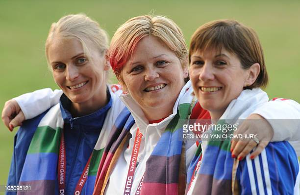 Anita North of England poses with Shona Marshall of Scotland and Gaby Ahrens of Namibia during the medal presentation ceremony for the women's...