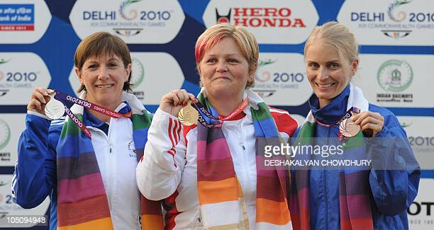 Anita North of England Scotland's Shona Marshall and Gaby Ahrens of Namibia pose with their respective gold silver and bronze medals during the...
