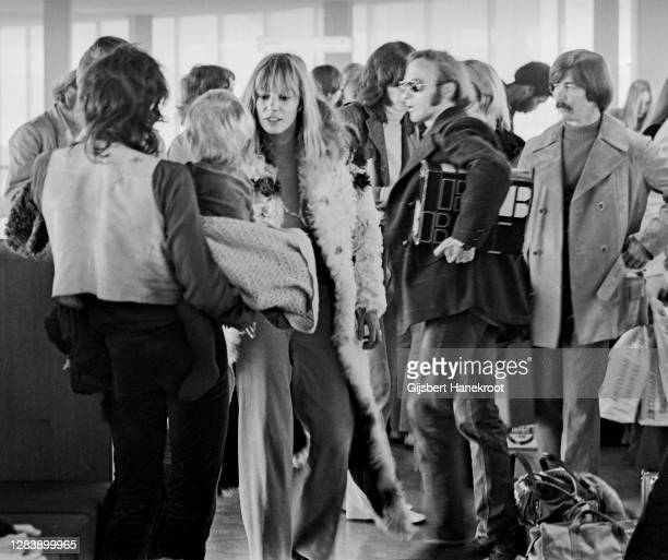 Anita Pallenberg with Keith Richards of The Rolling Stones and Steven Stills at Schiphol Airport, Netherlands, returning home after the last date of...