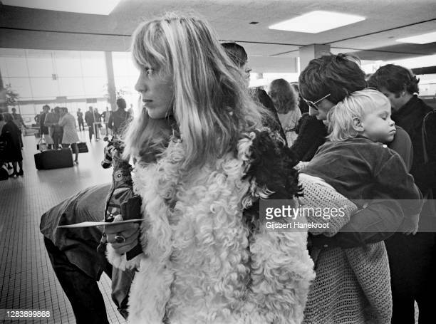 Anita Pallenberg with Keith Richards of The Rolling Stones holding their son Marlon at Schiphol Airport, Netherlands, returning home after the last...