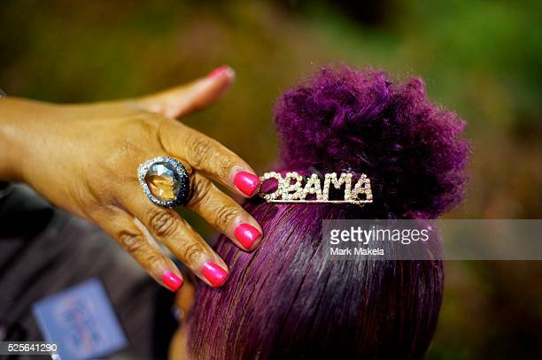 Anita Phoenix a Hofstra graduate from Long Island displays her hair pin in support of President Obama outside a campus watch party for the second...