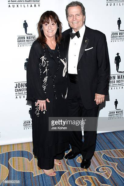 Anita Swift and Patrick Wayne attend the John Wayne cancer institute auxiliary's 28th annual odyssey ball at the Beverly Wilshire Four Seasons Hotel...