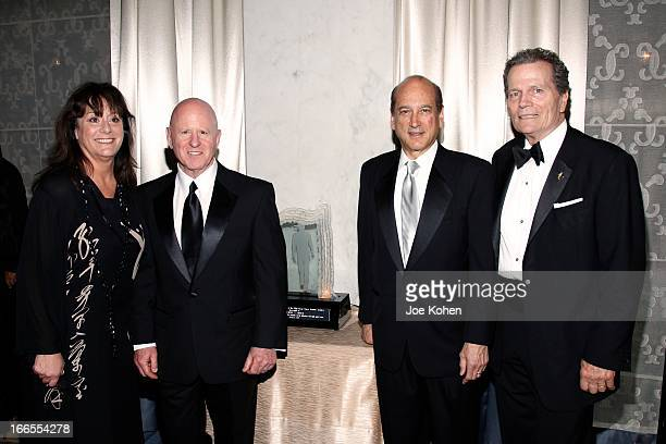 Anita Swift H Steven Blum Michael Sitrick and Patrick Wayne attend the John Wayne cancer institute auxiliary's 28th annual odyssey ball at the...