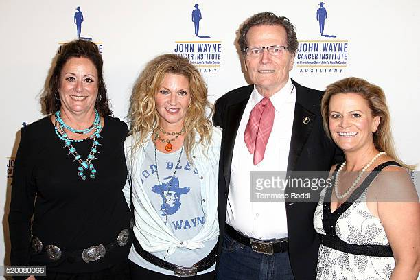 Anita Swift Marisa Wayne Patrick Wayne and Melanie Wayne attend the John Wayne Cancer Institute's 31st Annual Odyssey Ball at the Beverly Wilshire...