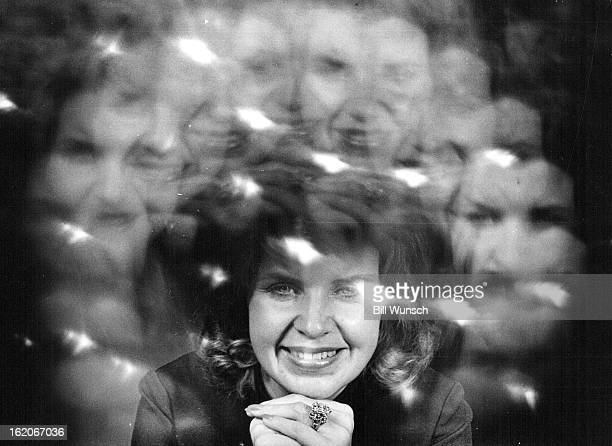 SEP 18 1972 SEP 23 1972 OCT 1 1972 Anita Viksne shows off her favorite piece of jewelry Photo was taken through multifaceted replica of the Orloff...
