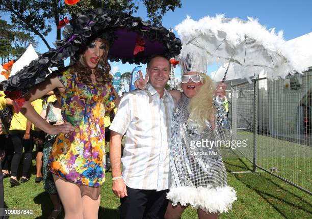 Anita Wiggleit and Miss Mole from Christchurch pose with New Zealand Prime Minister John Key at Big Gay Out on February 13 2011 in Auckland New...