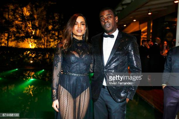 Anitta and Seu Jorge attend the 7th Annual amfAR Inspiration Gala on April 28 2017 in Sao Paulo Brazil