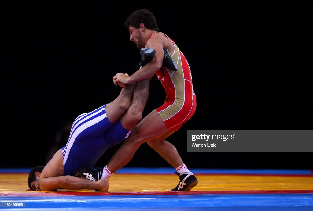 Aniuar Geduev of Russia pins down Ashraf Aliyev of Azerbaijan during the Men's Freestyle 74kg bout during the Wrestling LOCOG Test Event for London 2012 at ExCel on December 11, 2011 in London, England.