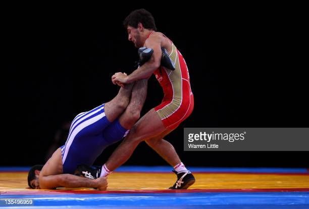 Aniuar Geduev of Russia pins down Ashraf Aliyev of Azerbaijan during the Men's Freestyle 74kg bout during the Wrestling LOCOG Test Event for London...