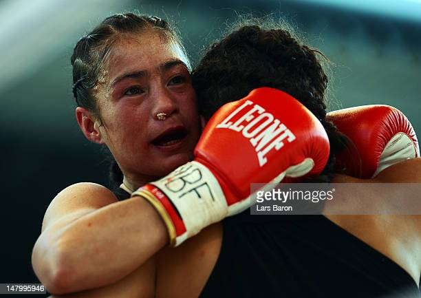 Aniya Seki of Switzerland punches Eva Marcu of Hungary during their WIBF and GBU Female Championship figth prior to the WBA IBF WBO and IBOheavy...
