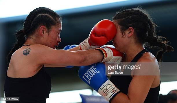 Aniya Seki of Switzerland punches Eva Marcu of Hungary during their WIBF and GBU Female Championship figth prior to the WBA IBF WBO and IBOheavy...