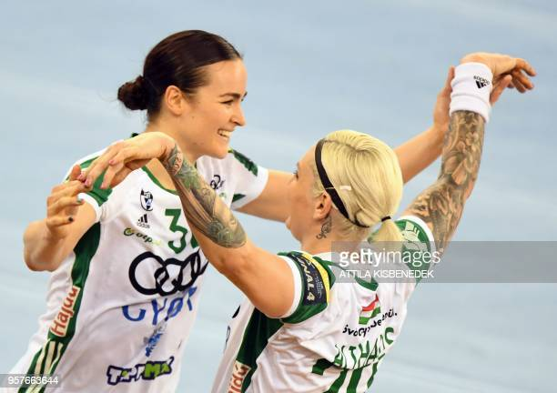 Anja Althaus and Yvette Broch of Hungarian Gyor Audi ETO celebrate their victory over Romanian CSM Bucuresti at the end of their semifinal match of...