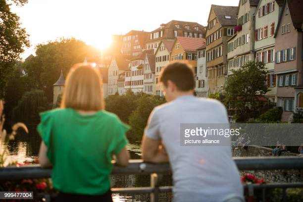 Anja and Alex watch the sunset in Tuebingen Germany 28 August 2017 Photo Sebastian Gollnow/dpa