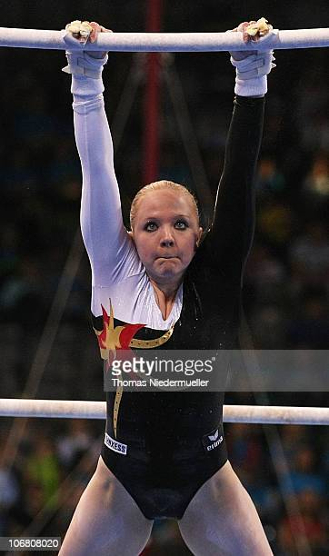 Anja Brinker of Germany performs at the uneven bars during the EnBW Gymnastics Worldcup 2010 at the Porsche Arena on November 13 2010 in Stuttgart...