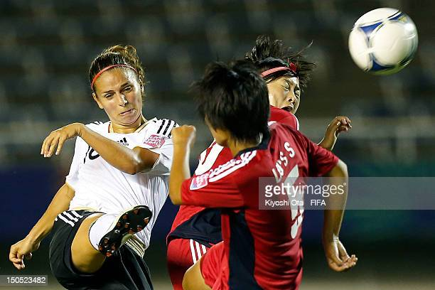 Anja Hegenauer of Germany and Liu Shanshan of China compete for the ball during the FIFA U20 Women's World Cup Japan 2012 Group D match between...