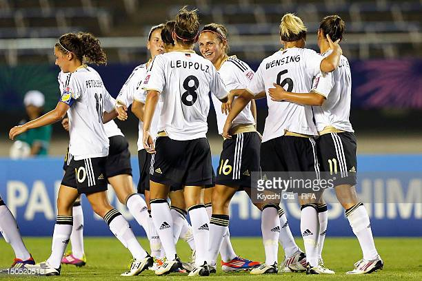 Anja Hegenauer of Germany celebrates her goal against China with teammates during the FIFA U20 Women's World Cup Japan 2012 Group D match between...