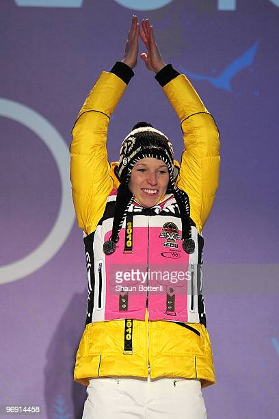 Anja Huber of Germany receives the bronze medal during the medal ceremony for the women's skeleton held at the Whistler Medals Plaza on day 9 of the...