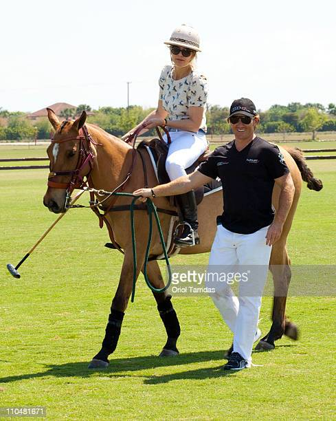 Anja Kaehny and Marc Ganzi attend the Audi Best Buddies Polo Experience at Grand Champions Polo Club on March 19 2011 in Wellington Florida