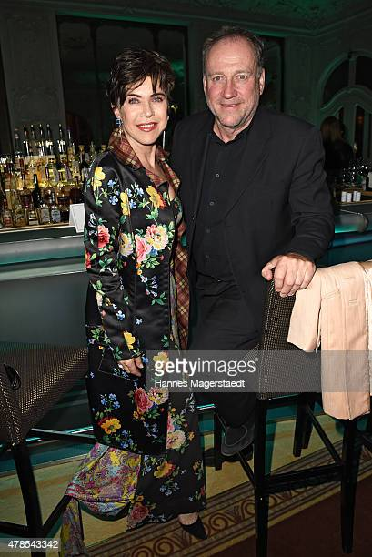 Anja Kruse and Harold Faltermeyer attend the Opening Night of the Munich Film Festival 2015 at Bayerischer Hof on June 25 2015 in Munich Germany