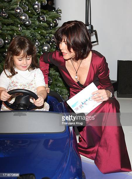 Anja Kruse With A Child From The Village Sos Children's Villages Light at the opening Bmw Of Art Advent Calendar in Berlin