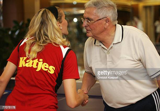 Anja Mittag congratuloates German Football Association president Theo Zwanziger after loosing the table tennis after the Women's German National Team...