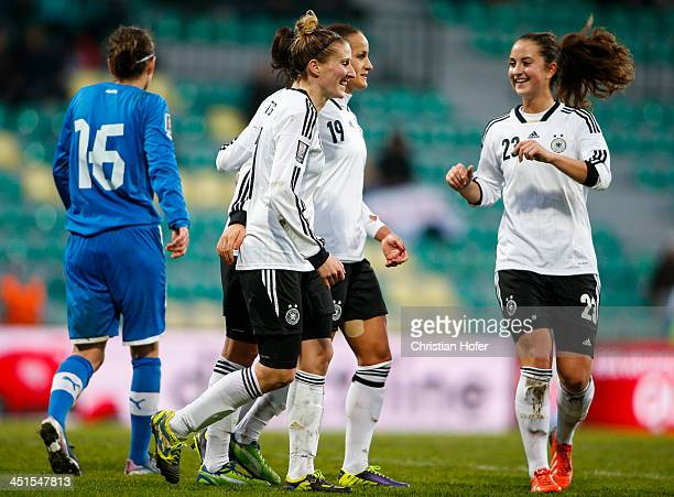 Anja Mittag, Fatmire Bajramaj and Sara Daebritz of Germany celebrate after scoring during the FIFA Women's World Cup 2015 Qualifier between Slovakia...