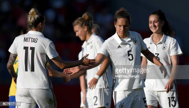 Anja Mittag of Germany and Babett Peter of Germany celebrate after the Women's International Friendly match between Germany and Brazil at BWTStadion...