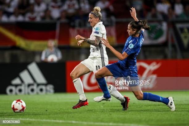 Anja Mittag of Germany and Cecilia Salvai of Italy battle for the ball during the UEFA Women's Euro 2017 at Koning Willem II Stadium on July 21 2017...