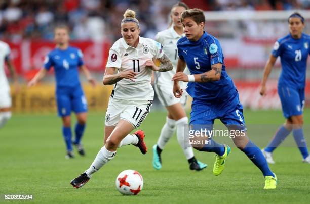 Anja Mittag of Germany and Elena Linari of Italy compete for the ball during the Group B match between Germany and Italy during the UEFA Women's Euro...