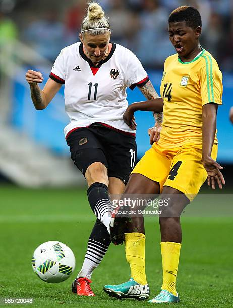Anja Mittag of Germany and Eunice Chibanda of Zimbabwe in action during the match between Zimbabwe and Germany for summer olympics at Arena...