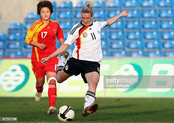 Anja Mittag of Germany and Pang Fengyue of China battle for the ball during the Woman Algarve Cup match between Germany and China at the Estadio...