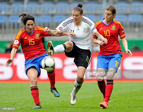 Anja Mittag of Germany battles for the ball with Silvia Meseguer and Adriana Martin of Spain during the UEFA Women's Euro Qualifier Group 2 match...