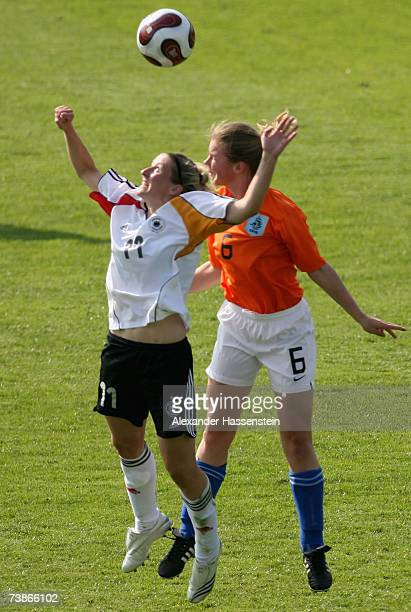 Anja Mittag of Germany challenge for the ball with Anouk Hoogendijk of the Netherlands during the UEFA Womens Championship qualification round match...