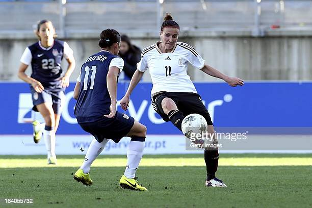 Anja Mittag of Germany challenges Ali Krieger of USA during the Algarve Cup 2013 Final at the Estadio Algarve on March 13 2013 in Faro Portugal