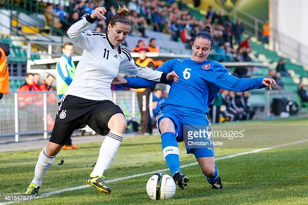 Anja Mittag of Germany competes for the ball with Andrea Vrabcova of Slovakia during the FIFA Women's World Cup 2015 Qualifier between Slovakia and...