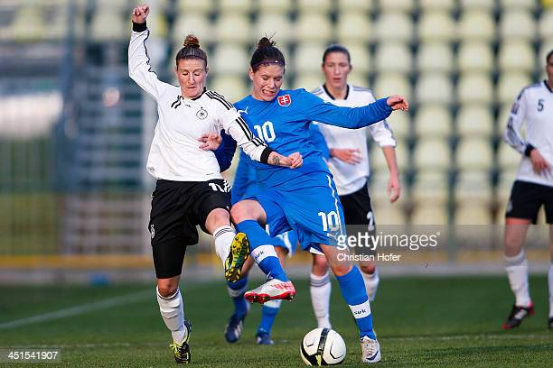 Anja Mittag of Germany competes for the ball with Lucia Onrusova of Slovakia during the FIFA Women's World Cup 2015 Qualifier between Slovakia and...
