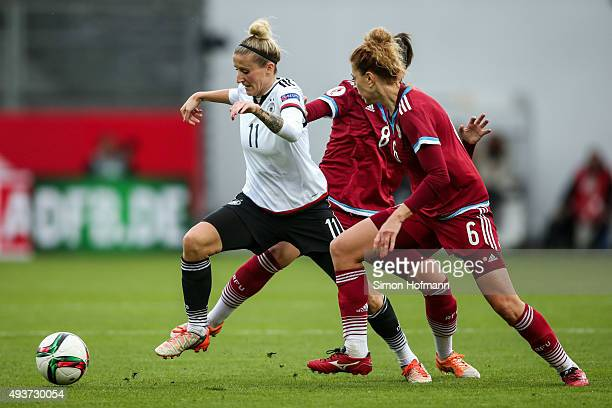 Anja Mittag of Germany is challenged by Anastasia Kostyukova of Russia during the UEFA Women's Euro 2017 Qualifier match between Germany and Russia...