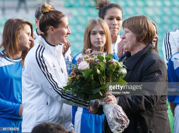 Anja Mittag of Germany is honored prior to the FIFA Women's World Cup 2015 Qualifier between Slovakia and Germany at Stadion pod Dubnom on November...