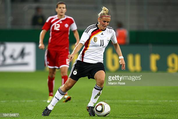 Anja Mittag of Germany runs with the ball during the Women's International Friendly match between Germnay and Canada at Rudolf Harbig stadium on...