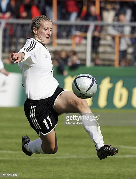 Anja Mittag of Germany runs with the ball during the Women's International friendly match between Germany and Canada on April 21 2005 in Osnabruck...