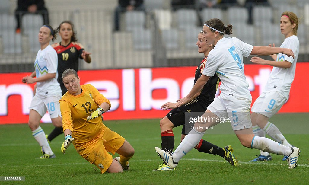 Anja Mittag (C) of Germany scores a goal during the Qualifying Round - FIFA Women's World Cup between Slovenia and Germany at SRC Bonifika stadio on October 26, 2013 in Koper, Slovenia.