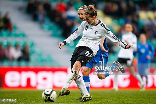 Anja Mittag of Germany scores against Patricia Fischerova of Slovakia during the FIFA Women's World Cup 2015 Qualifier between Slovakia and Germany...
